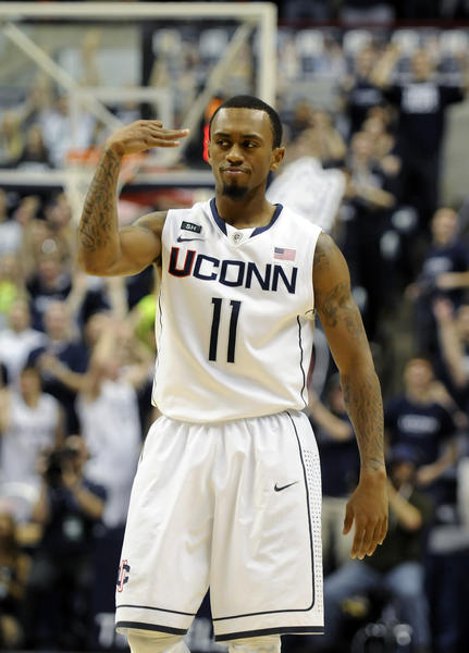 UConn guard Ryan Boatright signals a three-pointer during the second half against USF at Gampel Pavilion Sunday afternoon in Storrs. Boatright finished with 17 points in 43 minutes to help UConn to a 69-64 victory in OT.