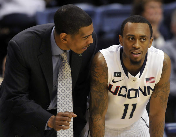 UConn coach Kevin Ollie has some words of wisdom for guard Ryan Boatright at Gampel Pavilion Sunday afternoon.