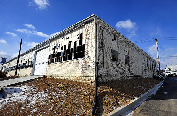 Three buildings on a tract off Baltimore Street in Hagerstown, now owned by Washington County, have fallen into disrepair over the years. Among them is the former Massey Auto Body shop.
