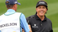 Phil Mickelson held off a last-day charge by playing partner Brandt Snedeker to end a week of scintillating golf with a four-shot triumph at the Phoenix Open in Scottsdale, Arizona on Sunday.