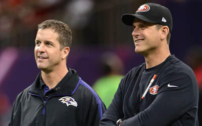 John Harbaugh, left, of the Baltimore Ravens and brother Jim Harbaugh of the San Francisco 49ers on the field before the start of Super Bowl XLVII.