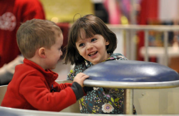 "Rachel Atter, 4, of East Hampton and Michael Thatford, 5, of Marlborough, enjoy their time on the ""Tea Cup"" ride at the 9th Annual Big Y Kids Fair, which was held Saturday and Sunday at the Connecticut Convention Center in Hartford."