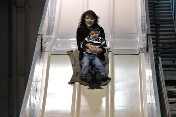 Aimee St. Thomas and her son Bradley, 3, enjoy the slide at the 9th Annual Big Y Kids Fair Sunday at the Connecticut Convention Center in Hartford.