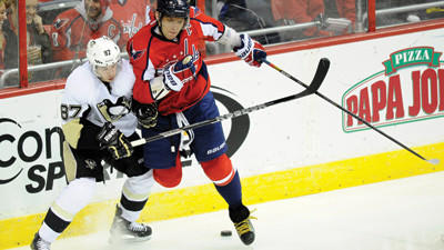 Washington Capitals left wing Alex Ovechkin battles for the puck along the boards against Pittsburgh Penguins center Sidney Crosby during the third period of an NHL hockey game on Sunday.