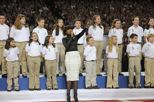 The Sandy Hook Elementary School chorus sang 'America the Beautiful' with Grammy Award-winning singer Jennifer Hudson before the Super Bowl in New Orleans. The 26 children sang in memory of the 26 students and faculty killed by a gunman Dec. 14 in one of the worst school massacres in U.S. history.