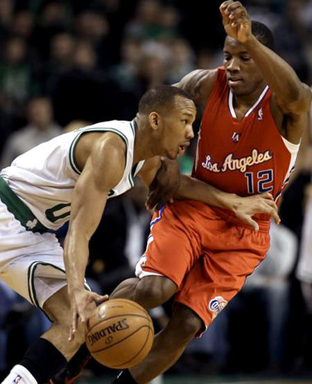 Clipper guard Eric Bledsoe tries to cut off a drive by Celtics guard Avery Bradley in the first quarter Sunday.
