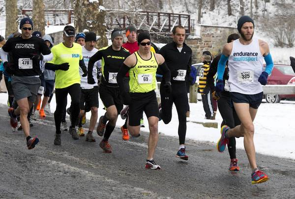 Runners leave the starting line during the Lehigh Valley Road Runners annual Super Bowl 10K on Sunday inside the Lehigh Parkway in Allentown. The run will help the club raise money for scholarships and donations. Last year, the Road Runners gave away $70,000 with six scholarships.