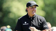 SCOTTSDALE, Ariz. (AP) — Phil Mickelson's 5-iron shot sailed long and right on the par-3 seventh, stopping an inch from the fringe and leaving him in danger of losing at least a stroke to playing partner Brandt Snedeker.