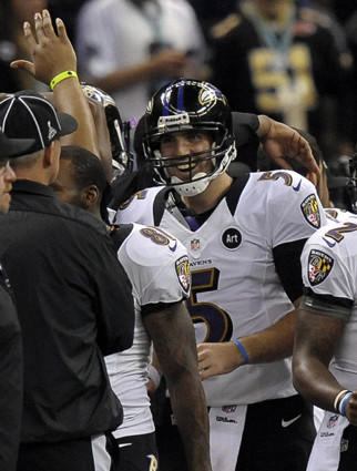 Joe Flacco celebrates his second-quarter touchdown pass to Jacoby Jones.