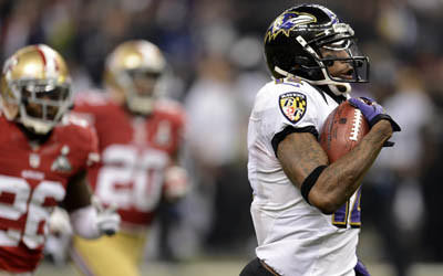 Jacoby Jones of the Baltimore Ravens runs for a touchdown in the third quarter against the San Francisco 49ers.