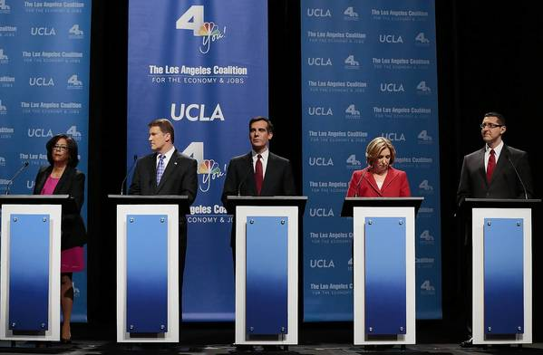 Mayoral candidates Jan Perry, left, Kevin James, Eric Garcetti, Wendy Greuel and Emanuel Pleitez debate at Royce Hall on Jan. 28.