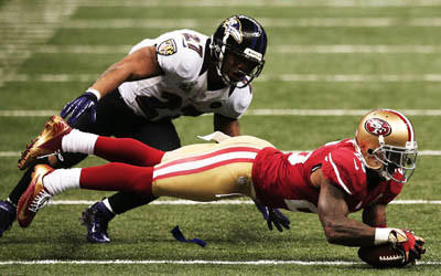 Tarell Brown of the San Francisco 49ers recovers a fumble by Ray Rice of the Baltimore Ravens in the third quarter during Super Bowl XLVII.
