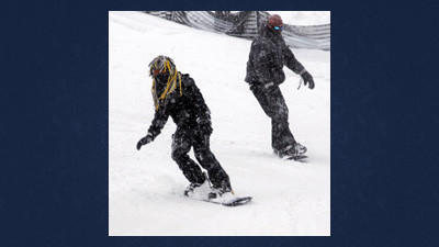 Jerard Lecato (left), Baltimore, Md., and Donyell Joseph, Boston, Mass., make one of their first runs down the mountain.