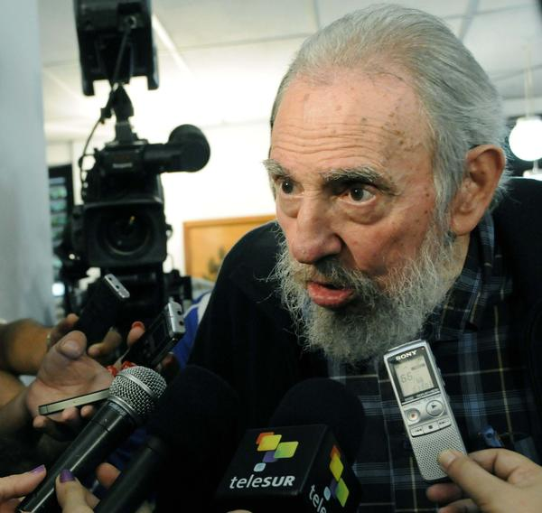 Former Cuban leader Fidel Castro speaks to reporters at a polling station in Havana February 3, 2013. Castro, 86, voted in Cuba's general election on Sunday and chatted with well wishers and Cuban reporters in Havana for more than an hour, in his first extended public appearance since 2010.
