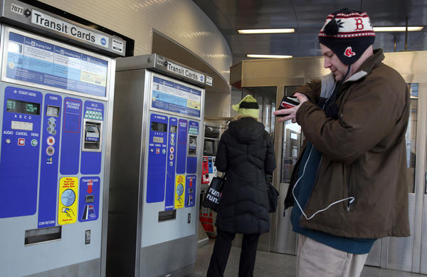 CTA riders add money to their fare cards at the CTA Red Line North/Clybourn Station.