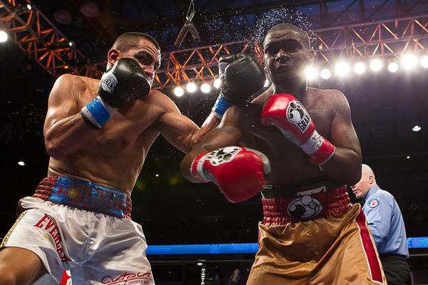 """Chicago's Carlos Molina delivers a left hand to Corey Spinks during ESPN's """"Friday Night Fights"""" on Feb. 1 at the UIC Pavilion."""