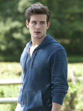 "Nico Tortorella, stars in Fox's ""The Following"" as Jacob Wells, got his first acting job at age 8 when he played a munchkin in ""The Wizard of Oz"" at a children's theater in his hometown of Wilmette. He graduated from New Trier High School, appearing in plays throughout the Chicago area where, he says, was a RedEye reader. He got the first of his ""10 or 11"" tattoos in Chicago and was driven to the tattoo parlor by his mother.