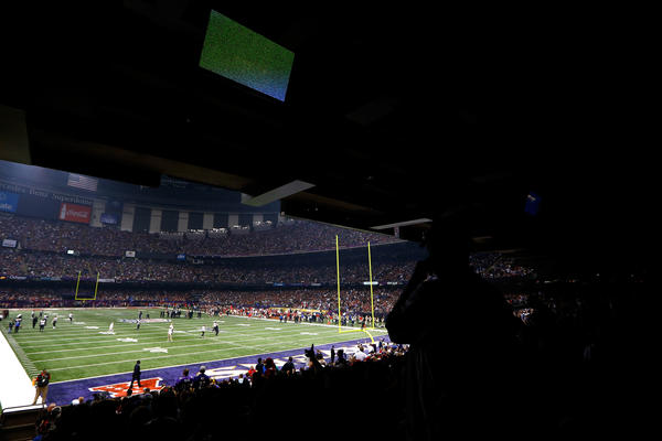 Fans look on to the field after a sudden power outage in the second quarter of Super Bowl XLVII at the Mercedes-Benz Superdome in New Orleans.