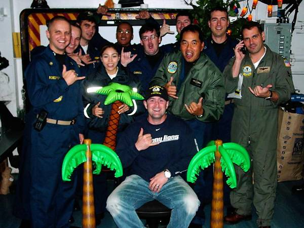 Northampton native and former Phillies player Brian Schneider (center) is shown with Navy sailors and pilots on the aircraft carrier USS Carl Vinson during one of his trips to visit troops.