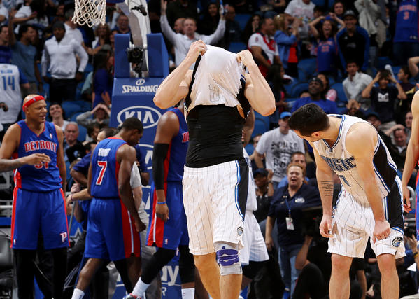 Orlando Magic center Nikola Vucevic covers his face with his jersey after another close loss after their game against the Detroit Pistons on January 27, 2013 at the Amway Center. The Pistons won the game 104-102.