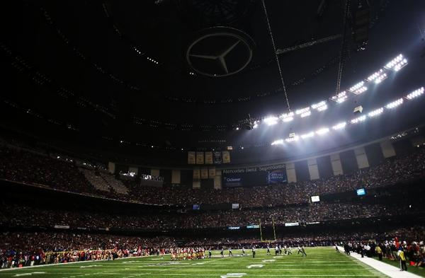 Super Bowl play is stopped after power went out in half of the New Orleans Superdome.