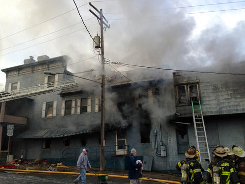 Firefighters battle a multialarm fire at a historic building at the corner of Potomac and Conococheague streets in Williamsport on Monday morning.