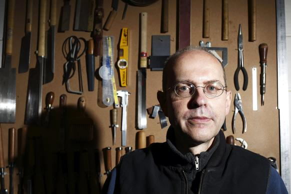 Canadian-born furniture maker Michael Ibsen, a direct descendant of the eldest sister of King Richard III, poses in his furniture workshop in London. A DNA sample from Ibsen was used to confirm that recently uncovered skeletal remains are those of the English king.