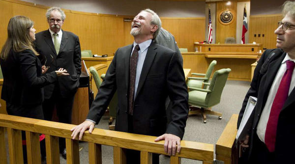 Michael Morton had reason to smile a year ago after Judge Sid Harle ruled in favor of a court of inquiry for Judge Ken Anderson at the Williamson County Justice Center in Georgetown, Texas. At right is Morton's attorney Barry Scheck. Second from left is Morton's original trial lawyer Bill Allison.