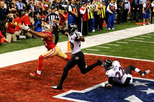 San Francisco's Michael Crabtree, defended by Baltimore's Ed Reed and Jimmy Smith, can't get to a fourth-down pass in the end zone during the final minutes of Super Bowl XLVII.