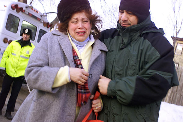 A woman leaves the parking lot of the Greenwood Health Center nursing home Wednesday, Feb. 26, 2003, after 16 people were killed in the early morning fire. Relatives rushed to the nursing home to find out if their loved ones were dead or alive.
