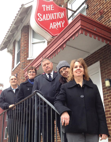 One of Volvo Group Hagerstown Sites Operational Development teams raised $32,000 for The Salvation Army in Hagerstown. Team members, front to back, are Kim Draper, Kathy Miller, Melanie Hollinger and John Saunders. In the middle, wearing a tie, is Maj. Robert D. Lyle of The Salvation Army.