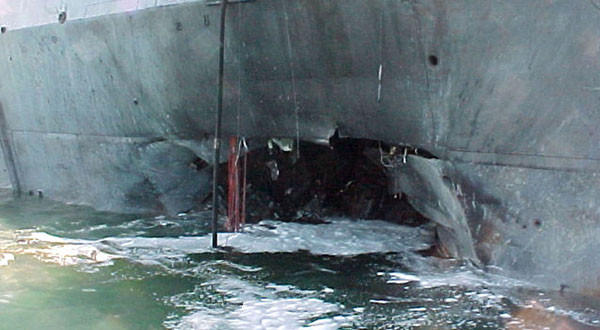 This image provided by the U.S. Navy shows damage sustained on the port side of the guided missile destroyer Cole after it was attacked in the waters off Yemen in October 2000.