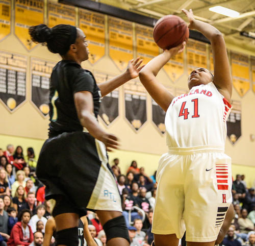 Lake Highland Prep's Karrah Johnson (41) shoots over Atlantic's Ronni Williams (1) during third quarter action of a Class 4A District 7 girls basketball final against Atlantic in Orlando, Fla. on Saturday, February 02, 2013.