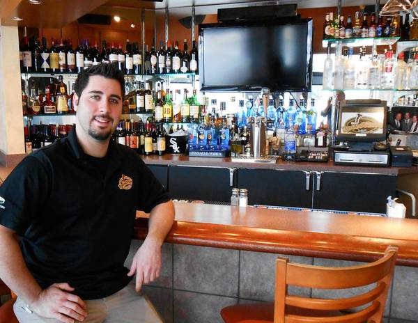 Tony Gloria sits in the bar of his Orland Park restaurant, RoccoVino's Italian Restaurant, which opened last May.