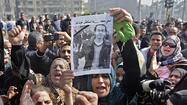 CAIRO -- An Egyptian opposition party alleged Monday that one of its members was tortured to death by police after he disappeared last week from a protest against the Islamist-led government of President Mohamed Morsi.