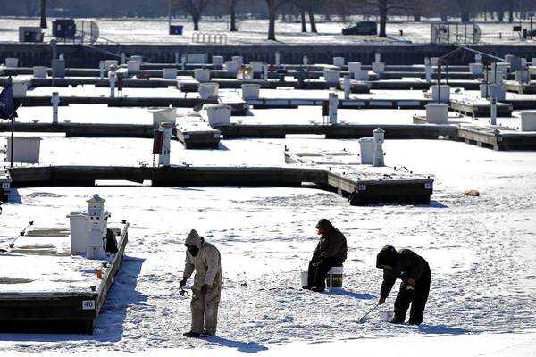 Ice fishermen wet their lines at Montrose Harbor in Chicago.