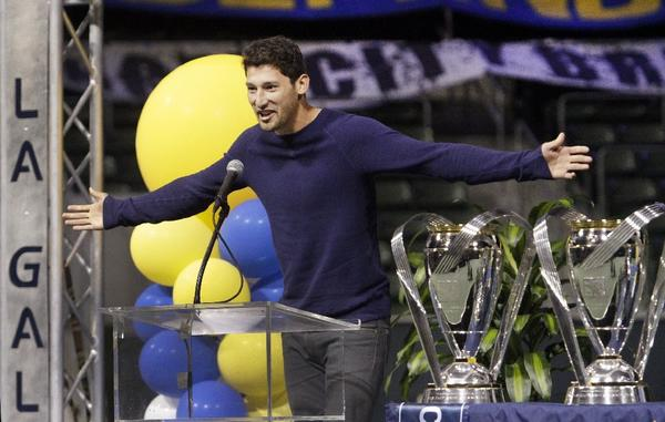 Galaxy defender Omar Gonzalez acknowledges the crowd during a celebration of the team's MLS Cup victory.