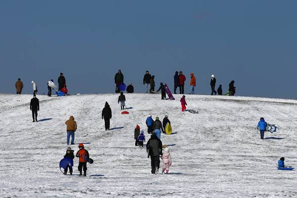 Sledders take to the slope near Montrose Harbor on a chilly and sunny Sunday in Chicago.