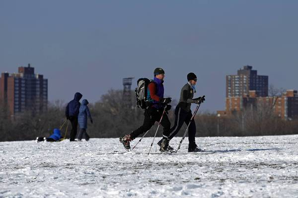 People cross country ski and sled near Montrose Harbor on a chilly and sunny Sunday in Chicago