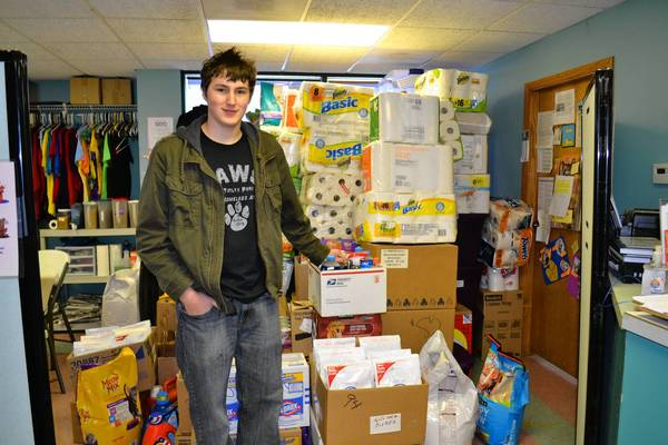 Nicholas Pavlik of Orland Park delivers pet supplies to PAWS in Tinley Park as part of his Eagle scout project.
