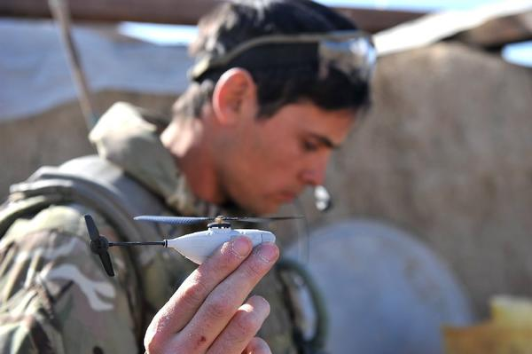 The Norwegian-designed Black Hornet Nano weighs about a half-ounce. The 4-inch-long drone is fitted with a tiny camera that relays still images and video to a remote terminal.