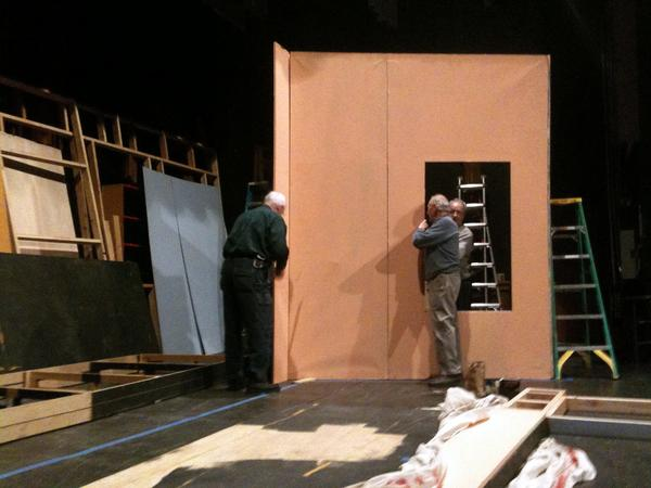"The volunteer crew at the Little Theatre of Manchester works to construct the wall of a living room set for the February production of ""Who's Afraid of Virginia Woolf?."""