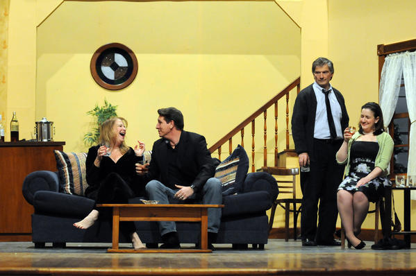 "Debi Freund, of Bolton, as Martha, Jim Power, of Manchester, as Nick, Mike Zizka, of Burlington, as George, and Trish Urso, of Windsor, as Honey (l-r) rehearse the first act for the Little Theatre of Manchester's upcoming production of ""Who's Afraid of Virginia Wolf?"" at Cheney Hall in Manchester. The show opens February 15 and runs through March 3."