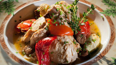 Braised Chicken Basquaise with red peppers and artichokes at Cafe de Paris, in Columbia