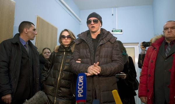 The Bolshoi Ballet's artistic director, Sergei Filin, speaks with reporters as he leaves a hospital in Moscow on Monday.