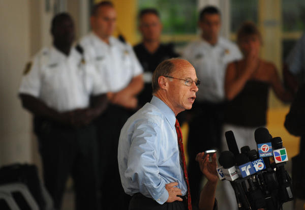 Broward Sheriff Ken Jenne speaks to the media as police personel stand in the back ground at Memorial regional Hospital in Hollywood. Jenne was at the hospital in Hollywood after BSO Deputy Maury Hernandez was shot during a traffic stop.