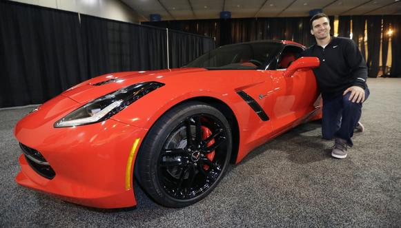 Baltimore Ravens quarterback Joe Flacco is presented with a 2014 Chevrolet Corvette Stingray for being named Super Bowl XLVII