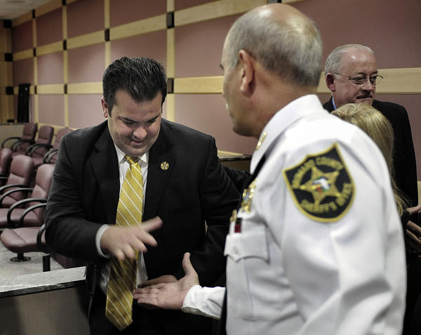 Broward Deputy Maury Hernandez shakes hands with Broward County Sheriff Al Lamberti after David Maldonado was found guilty of attempted murder for shooting Deputy Hernandez in the head.