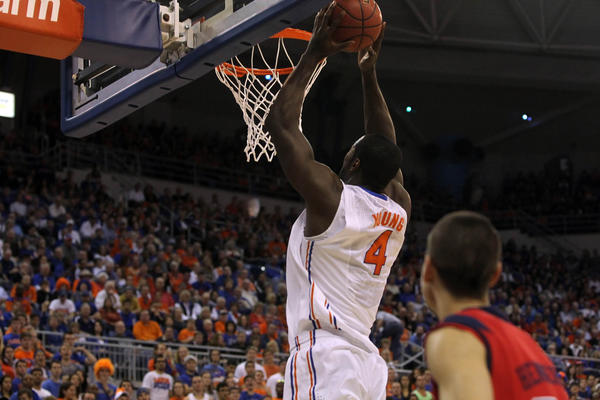 Florida Gators center Patric Young (4) dunks against the Ole Miss Rebels during the first half at the Stephen C. O'Connell Center.