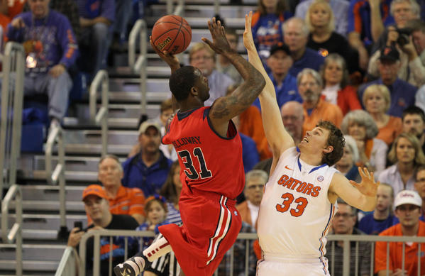 Florida Gators forward/center Erik Murphy (33) defends Ole Miss Rebels forward Murphy Holloway (31) during the first half at the Stephen C. O'Connell Center.